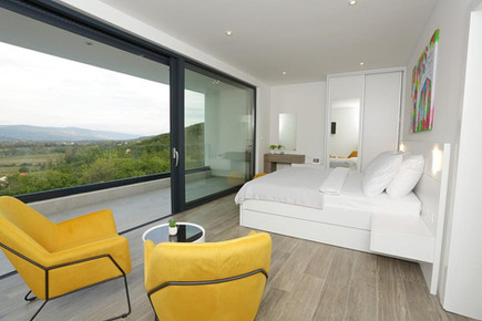 Bedroom with bathroom and view of Imotski field