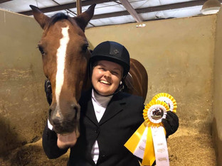 Walk/trot rider Jessica enjoying her first outside horse show with Rain