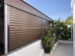 Roller garage door dark brown colour with cover produced form aluminium profile slats