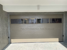 CUSTOM PRODUCED SECTIONAL DOOR WITH FULL VISION PANEL