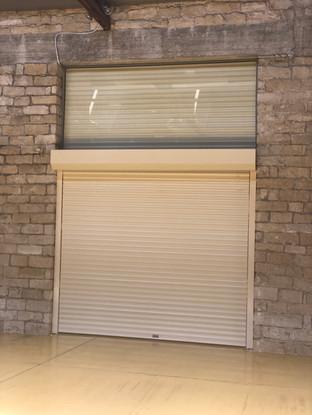 ALUMINIUM ROLLER DOOR IN BOX SUPPLIED AND INSTALLED BY PAN. CHRYSOSTOMOU AUTO DOORS LTD
