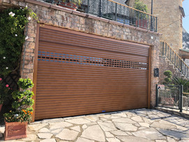 Roller garage door golden oak colour with vision profiles