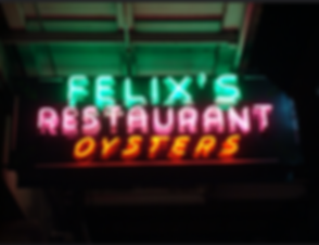 Neon sign hanging in front of Felix's Restaurant & Oyster Bar in New Orleans, LA