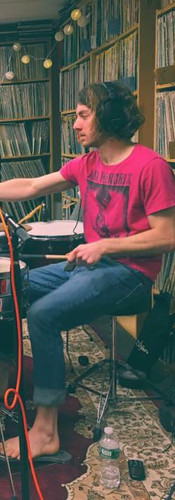 Sound checking his Gretsch drum kit during a WHUS in-studio session