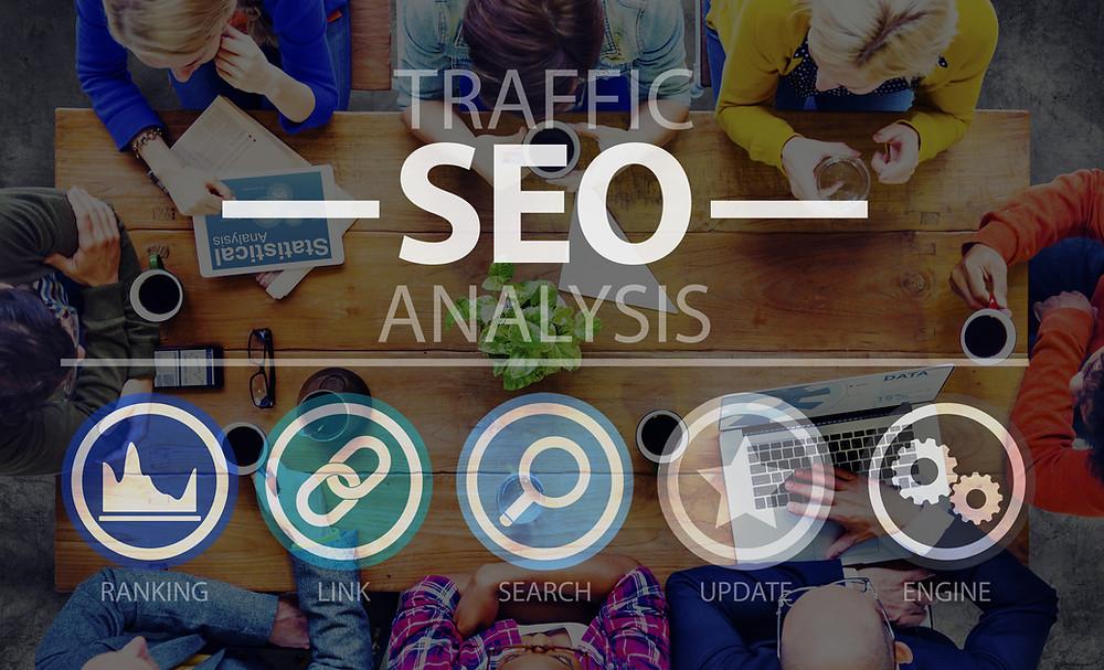 Talented marketing team researching keywords