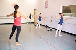 Photo of Ms. Felicia working on tendus to the side with Level 3 ballet dancers at the studio in Chula Vista, CA.