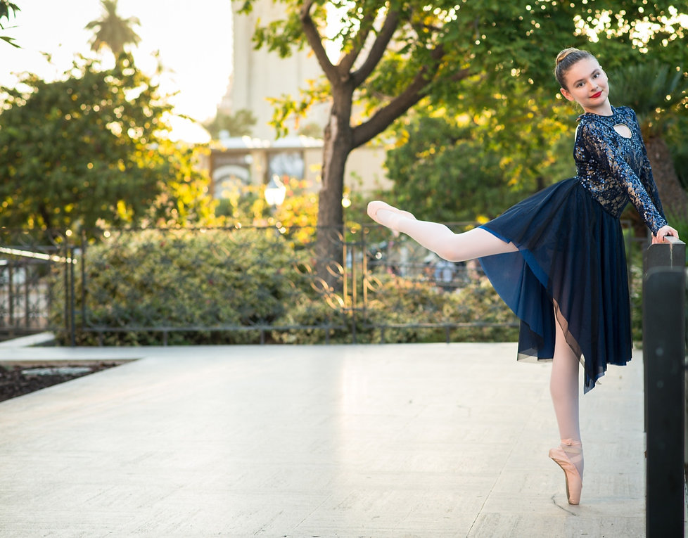 Teen ballet dancer from Inspire School of Ballet in attitude derriere position at Balboa Park in San Diego, CA.