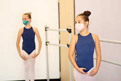 Level 3 ISB ballet dancers positioned ready to begin class. Students are socially distanced and wearing masks at the studio in Eastlake, CA.