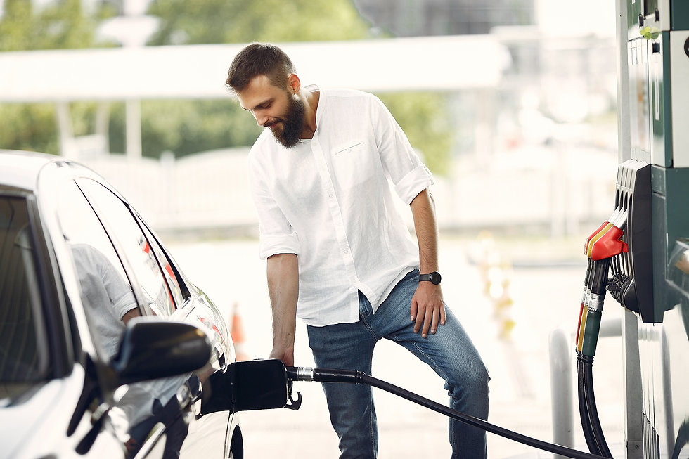 handsome-man-pours-gasoline-into-tank-of