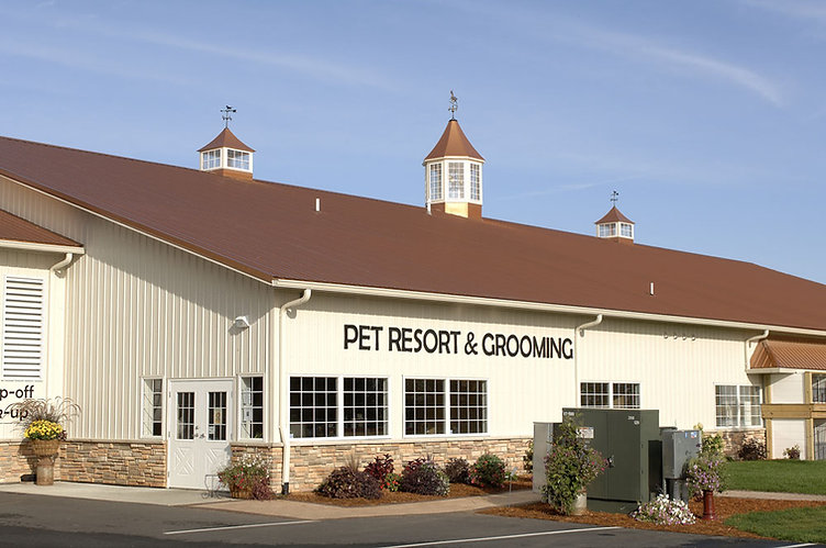 Pet Resort and Grooming building with square cupolas with windows and an octagon cupola with windows