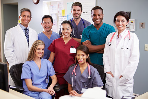 Portrait Of Medical Team At Nurses Station.jpg