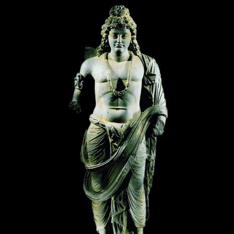 A monumental Gandhara Schist standing figure of a Bodhisattva