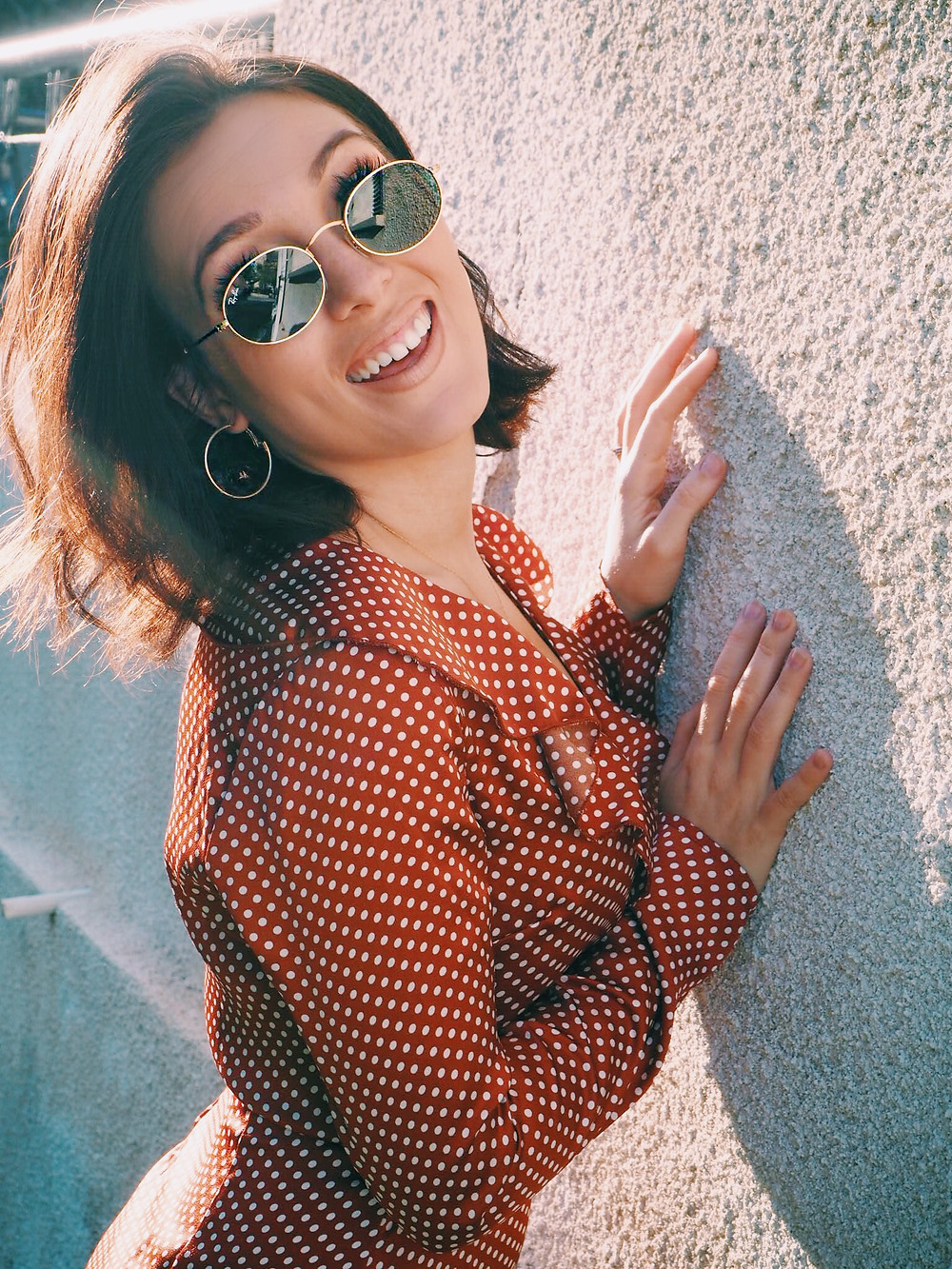 Ray ban ovals, Mini hoop earrings and a rust vintage polka dot dress