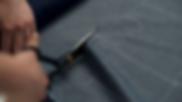 closeup-footage-of-woman-cutting-cloth-i