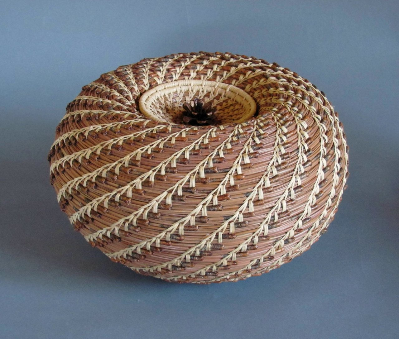 Inverted Vessel with pine cone lid