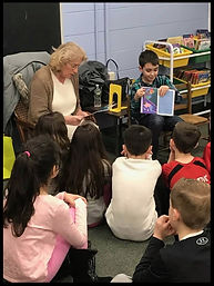 Lisa Brooks reads her book to school children in New Jersey
