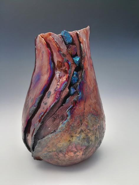 Raku vase with Peacock Ore setting
