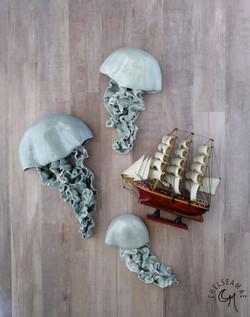 Light blue jellyfish wall sculpture