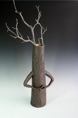 Tall black tree sculpture quiet