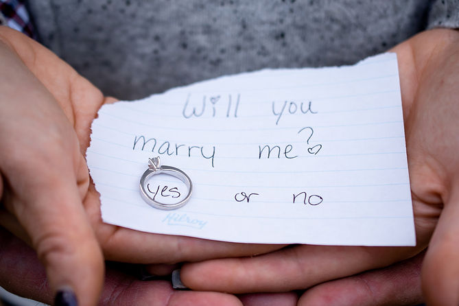 """Ring photo with """"Will you marry me?"""" text by Alberta wedding photographer at the MacTaggart Sanctury Trail Loop"""