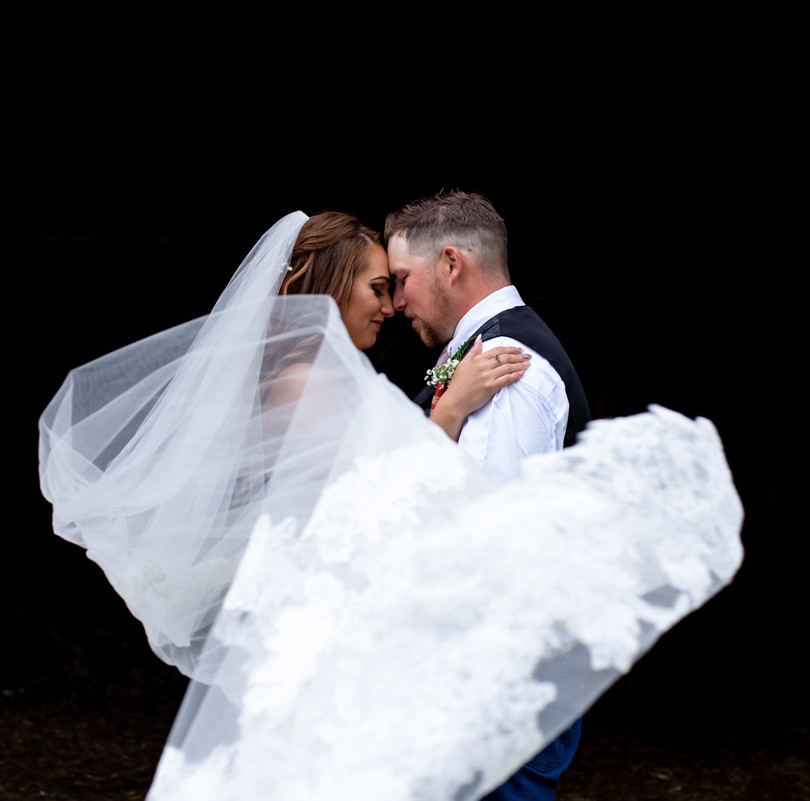 Edmonton wedding photographer captures image of bride and groom with veil blowing in the wind