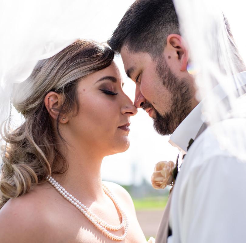 Edmonton wedding photographer Hearten Photography captures photo of bride and groom at St. Albert Trestle Bridge