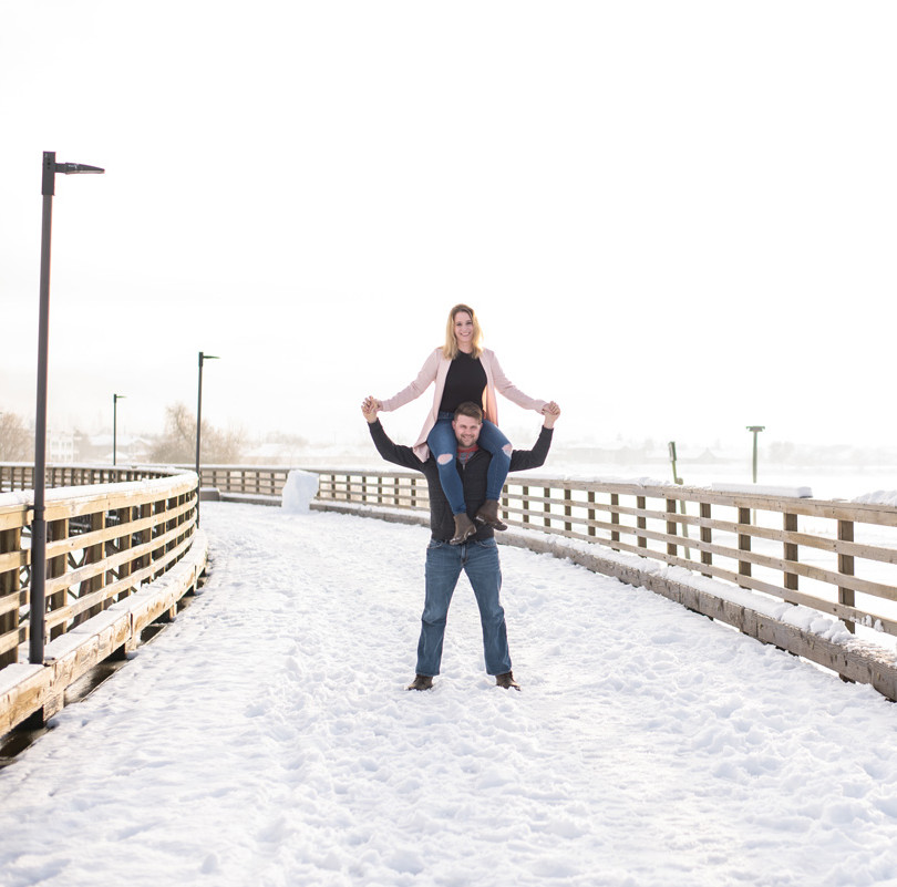 Winter couples photo on whark by edmonton professional photographer