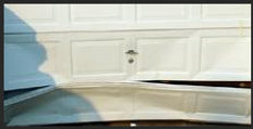 Bent Garage Door Panel, Damaged Garage Door Section, Kingwood, TX, Garage Door Repair, Garage Door