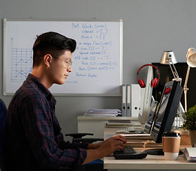 side-shot-young-asian-man-glasses-working-computer-office_edited.jpg