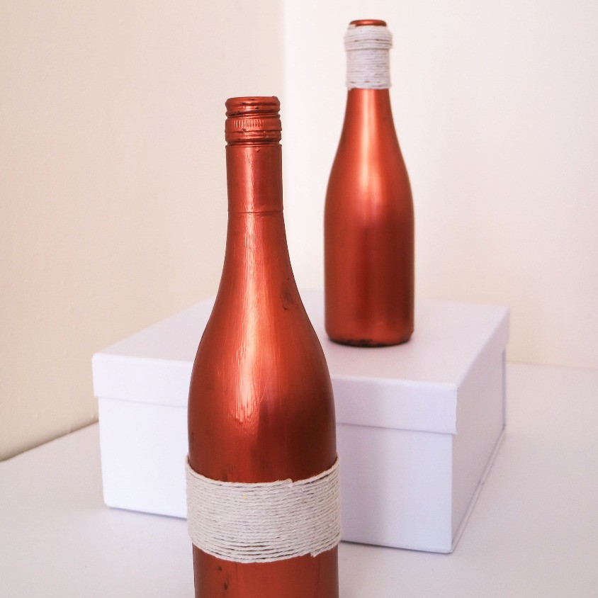 Klassic Karen creating a lux looking decor, it is two bronze glass bottles