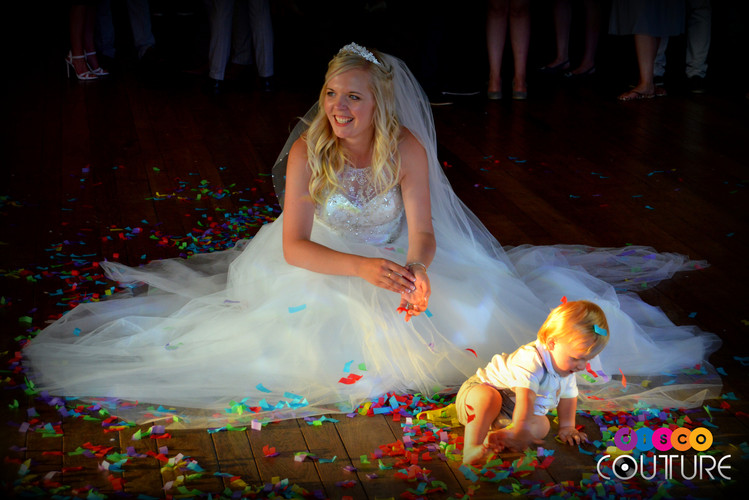 Mother and child playing in the confetti