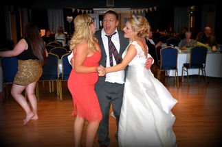 Father dances with daughters
