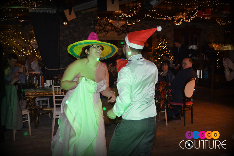 Couple dancing with silly hats
