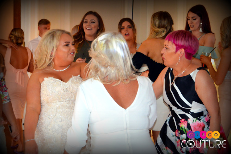 Bride dances with family