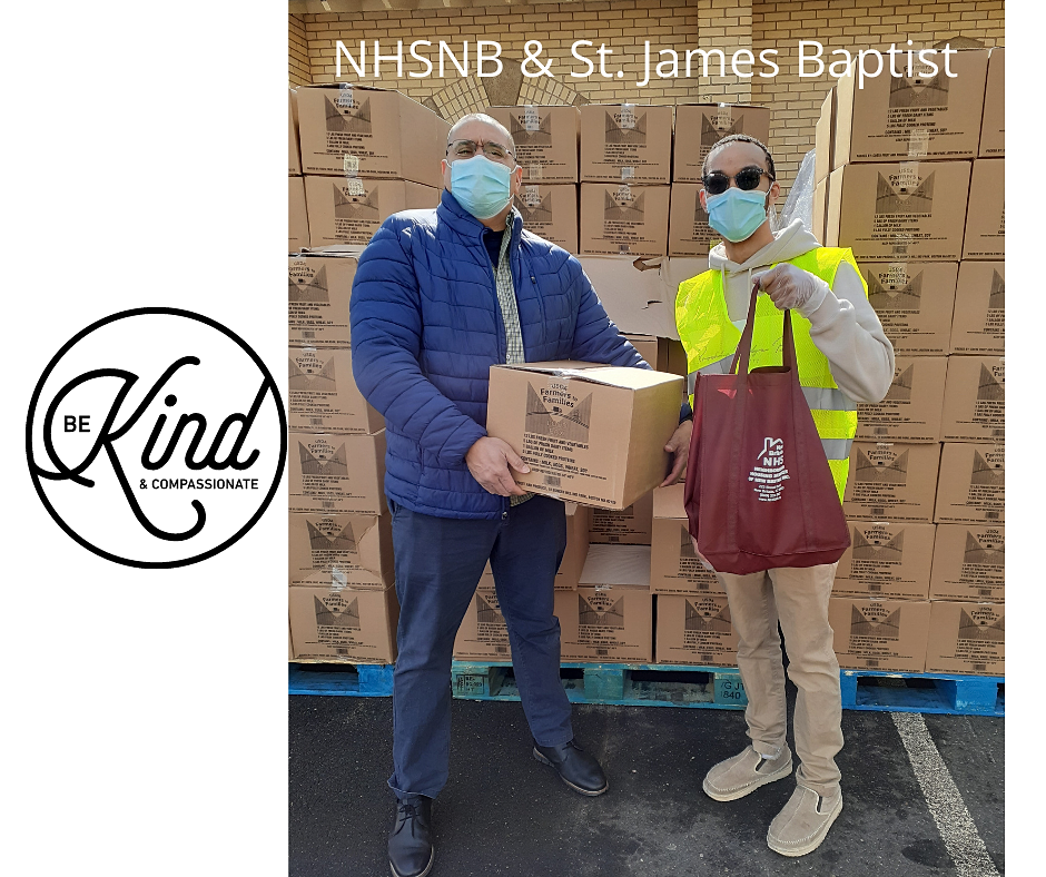 NHSNB Board Member Manuel Sandoval (Left) and NeighborWorks AmeriCorps VISTA Jeremy Amparo, help out at KIEDC's Farmers to Families Food Boxes Distribution Feb. 24, 2021. NHSNB provided 50 bags of personal care items. More than 1,000 boxes of food were given out.