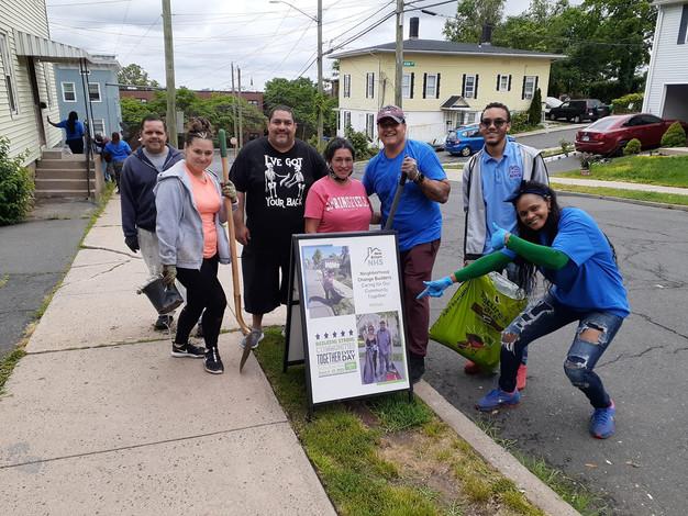 Photo Neigh. Change Builders 6.12.21 group w sidewalk sign (1).jpg