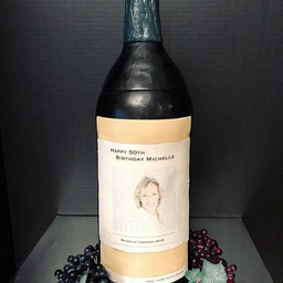 Personalized wine bottle cake for a spec