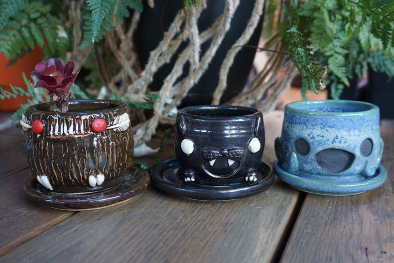 Mothman and cat planters