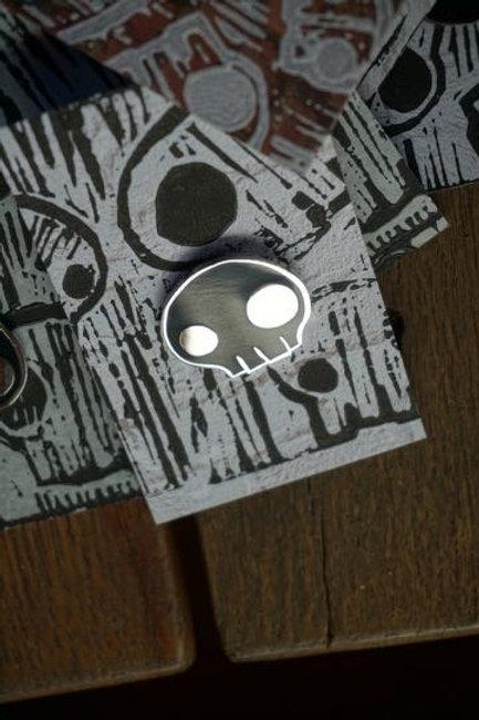 Silver lined Skull Pin