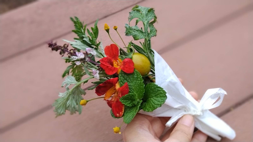 Edible bouquet with nasturtium, mint, cherry tomato and more.