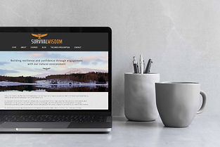 mockup of laptop with website homepage on screen with coffee cup and pencil pot in shot
