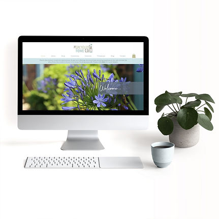 example of website design homepage on desktop mock up with coffee cup and plant