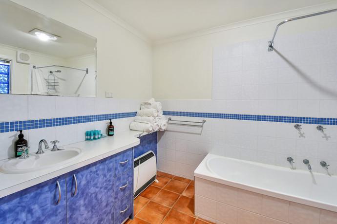 Family bathroom with bathtub