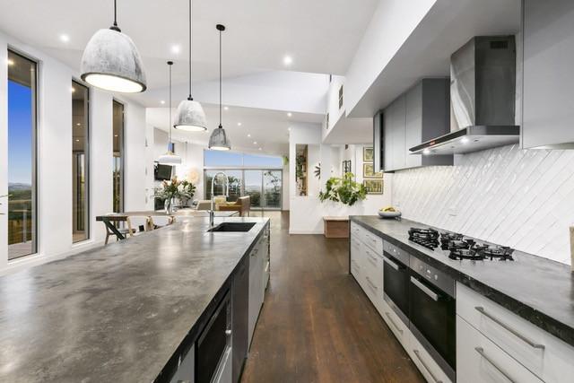 Sleek open galley style kitchen