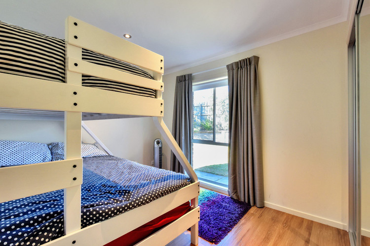 Bedroom 3 with tri bunks (single above and double below)