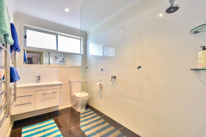 Modern bathroom with walk-in frameless shower