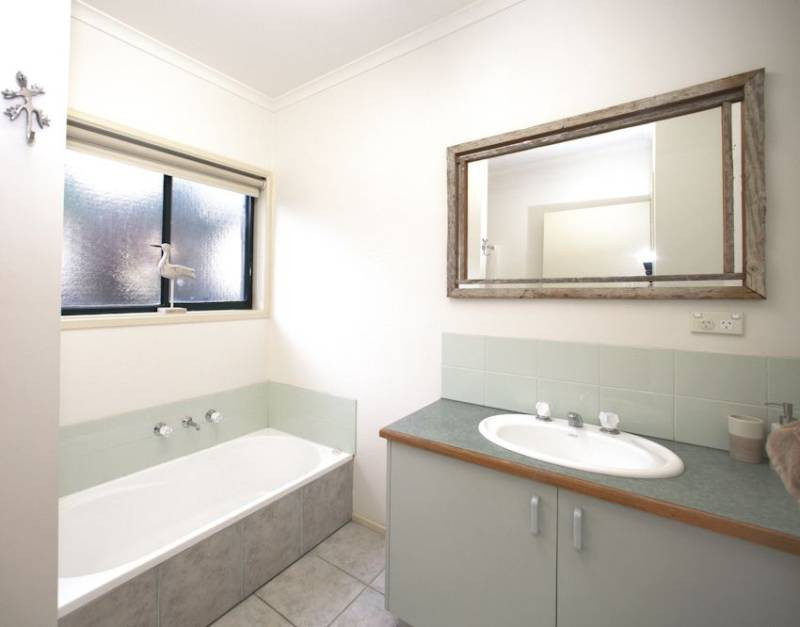 Central bathroom with bath tub