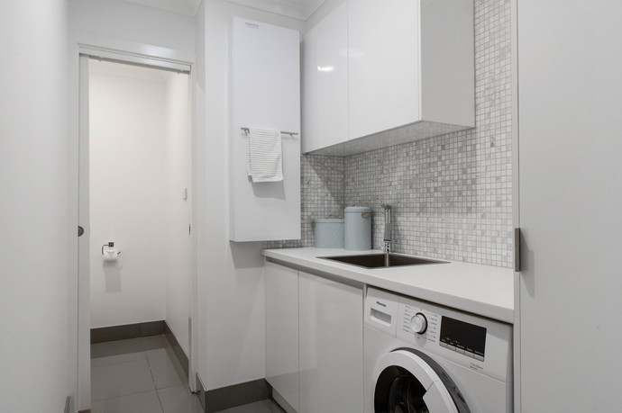 Modern laundry with washing machine