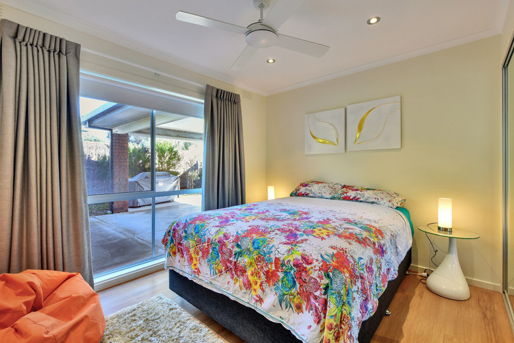 Bedroom 2 with queen size bed, ceiling fan and built in robes