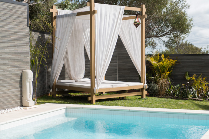 Day bed beside the pool.jpg